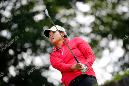 Yani Tseng, of China, follows her ball after playing on the 2nd hole during the second round of the Evian Championship women's golf tournament in Evian, eastern France