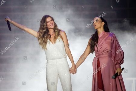 Gisele Bundchen and Ivete Sangalo on the World Stage supporting the Amazonia Live project, which promises to plant 1 million trees, at the official opening of Rock in Rio