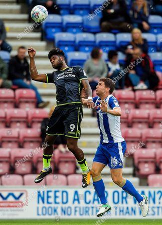 Ellis Harrison of Bristol Rovers challenges Alex Bruce of Wigan Athletic