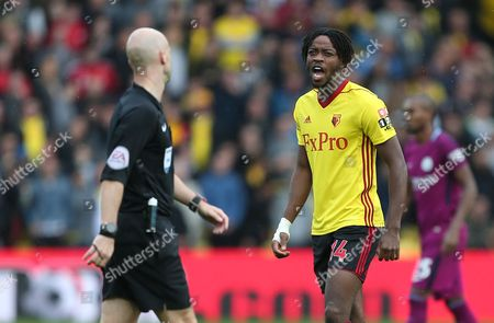 Nathaniel Chalobah of Watford complains to Referee Andy Taylor