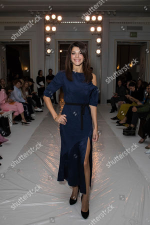 Natalie Anderson poses for photographers upon arrival at the Jasper Conran Spring/Summer 2018 runway show at London Fashion Week in London