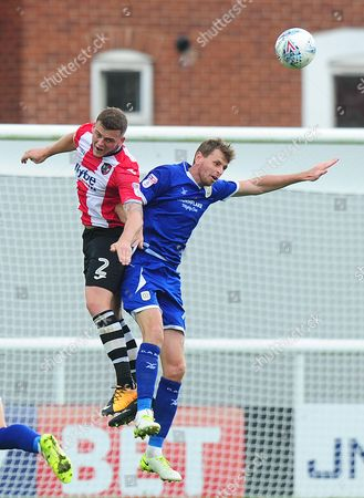 Pierce Sweeney of Exeter City battles for the ball with Chris Porter of Crewe Alexandra during the Sky Bet League 2 Match between Exeter City and Crewe Alexandra at St James Park, Exeter, Devon on September 16.