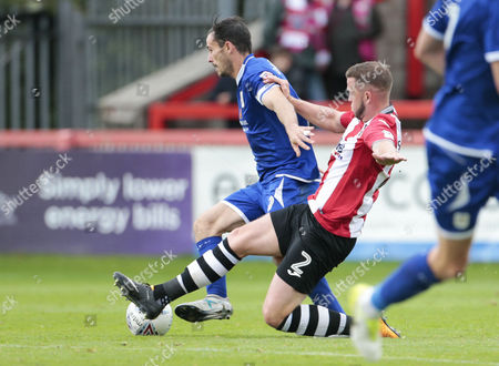 Pierce Sweeney of Exeter City challenges for the ball against Chris Dagnall of Crewe Alexandra during the Sky Bet League 2 Match between Exeter City and Crewe Alexandra at St James Park, Exeter, Devon on September 16.