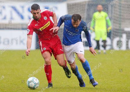 Glenavon vs Cliftonville. Glenavon's Andrew Hall with Cliftonville's Joe Gormley