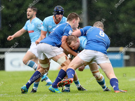 St. Mary's College vs Garryowen. Garryowen?s Mark Rowley is tackled by St.Mary?s Jack Dilger and David O?Connor