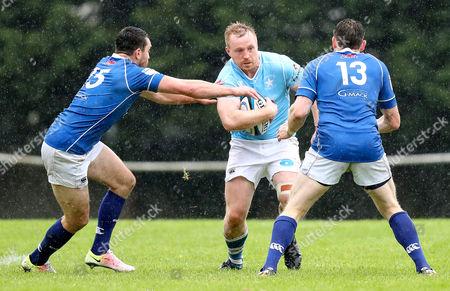 St. Mary's College vs Garryowen. St.Mary?s Dave Fanagan and Darren Moroney tackle Garryowen?s Mark Rowley