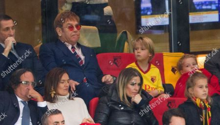Sir Elton John's watches match with his  son Zachary Furnish-John  who was a mascot for the match