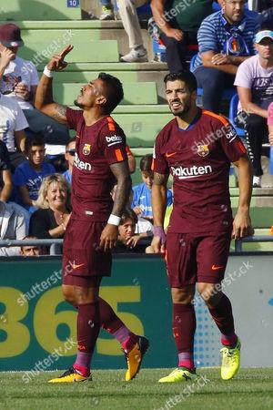 Jose Paulo Bezerra 'Paulinho' and Luis Suarez