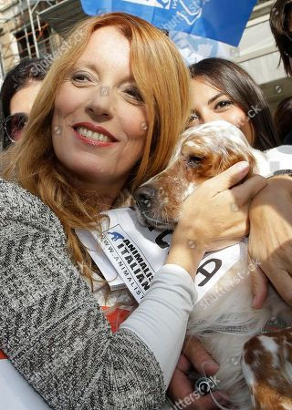 President and founder of the 'Movimento Animalista' Michela Vittoria Brambilla embraces a dog as she attends a rally during the presentation of the 'Movimento Animalista' party, in Milan, Italy