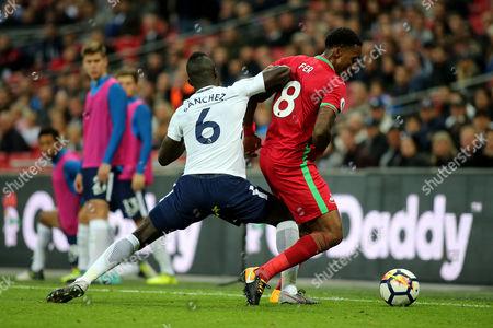 Leroy Fer of Swansea tries to shield the ball from Tottenham's Davinson Sanchez during Tottenham Hotspur vs Swansea City, Premier League Football at Wembley Stadium on 16th September 2017