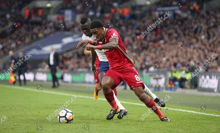 Leroy Fer of Swansea City beats Davinson Sanchez of Tottenham Hotspur