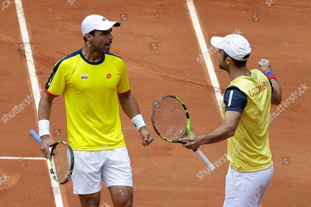 Juan Sebastian Cabal, Alejandro Falla. Colombia's Juan Sebastian Cabal, right, and Alejandro Falla, celebrate scoring a point against Croatia's Marin Cilic and Nikola Mektic, during their Davis Cup World Group play-offs doubles tennis match at the Santamaria Bullring in Bogota, Colombia