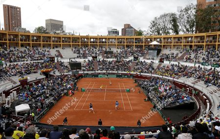Colombia's Juan Sebastian Cabal and Alejandro Falla play a shot from Croatia's Marin Cilic and Nikola Mektic during their Davis Cup World Group play-offs doubles tennis match at the Santamaria Bullring in Bogota, Colombia