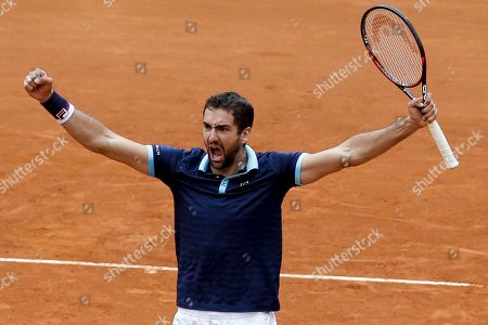 Croatia's Marin Cilic celebrates defeating Colombia's Juan Sebastian Cabal and Alejandro Falla during their Davis Cup World Group play-offs doubles tennis match at the Santamaria Bullring in Bogota, Colombia