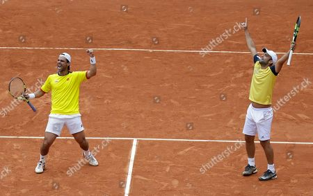 Juan Sebastian Cabal, Alejandro Falla. Colombia's Juan Sebastian Cabal, right, and Alejandro Falla celebrate scoring a point against Croatia's Marin Cilic and Nikola Mektic during their Davis Cup World Group play-offs doubles tennis match at the Santamaria Bullring in Bogota, Colombia