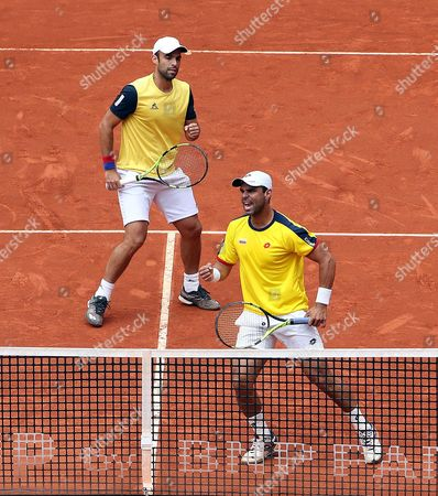 Stock Picture of Colombian Alejandro Falla (R) and Sebastian Cabal celebrate a point against Croatian Marin Cilic (L) and Nikola Mektic (R) during the doubles match of the Davis Cup World Group between Colombia and Croatia at La Santamaria bullring in Bogota, Colombia, 16 September 2017.