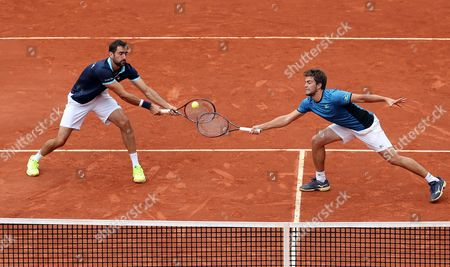 Stock Photo of Croatian Marin Cilic (L) and Nikola Mektic (R) in action against Colombian Alejandro Falla and Sebastian Cabal during the doubles match of the Davis Cup World Group between Colombia and Croatia at La Santamaria bullring in Bogota, Colombia, 16 September 2017.