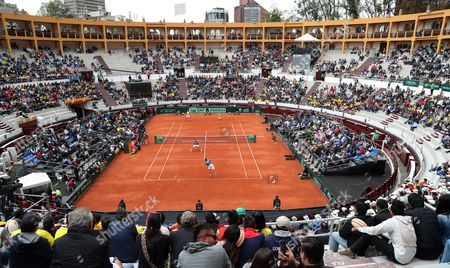 General view of Colombian Alejandro Falla and Sebastian Cabal (top) against Croatian Marin Cilic and Nikola Mektic during the doubles match of the Davis Cup World Group between Colombia and Croatia at La Santamaria bullring in Bogota, Colombia, 16 September 2017.
