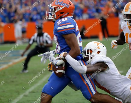 Justin Martin, Malik Davis. Tennessee defensive back Justin Martin, right, knocks the ball loose from Florida running back Malik Davis (20) on the 2-yard line after Davis had run 72-yards during the second half of an NCAA college football game, in Gainesville, Fla. The ball rolled out of the end zone for a touchback. Florida won 26-20