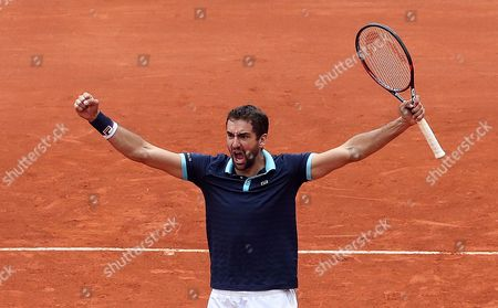 Croatian Marin Cilic celebrates with his teammate Nikola Mektic (out of frame) after defeating Colombians Alejandro Falla and Sebastian Cabal during the double match of the Davis Cup World Group between Colombia and Croatia at La Santamaria bullring in Bogota, Colombia, 16 September 2017.