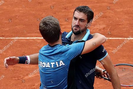 Croatian Nikola Mektic (L) and Marin Cilic (R) celebrate after defeating Colombian Alejandro Falla and Sebastian Cabal during the doubles match of the Davis Cup World Group between Colombia and Croatia at La Santamaria bullring in Bogota, Colombia, 16 September 2017.