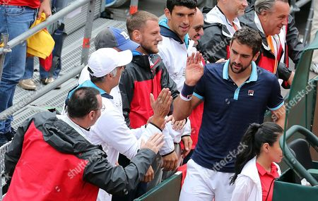 Croatian Marin Cilic (C) celebrates in the stands after defeating with his teammate Nikola Mektic (not in frame) defeating Colombians Alejandro Falla and Sebastian Cabal during the doubles match of the Davis Cup World Group between Colombia and Croatia at La Santamaria bullring in Bogota, Colombia, 16 September 2017.