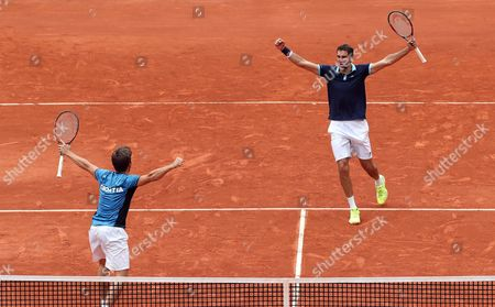 Stock Image of Croatian Nikola Mektic (L) and Marin Cilic (R) celebrate after defeating Colombian Alejandro Falla and Sebastian Cabal during the doubles match of the Davis Cup World Group between Colombia and Croatia at La Santamaria bullring in Bogota, Colombia, 16 September 2017.