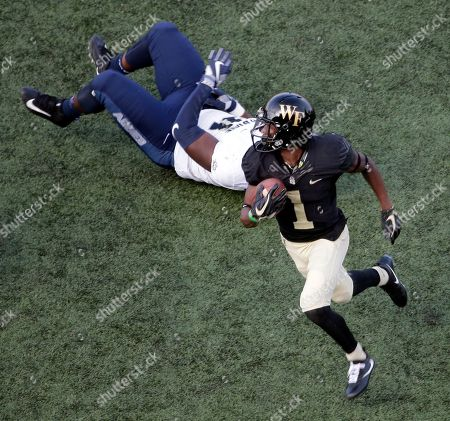 Tabari Hines, Devon Anderson. Wake Forest's Tabari Hines (1) runs past Utah State's Devon Anderson (91) after a catch in the second half of an NCAA college football game in Winston-Salem, N.C