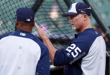Mark McGwire, Manuel Margot. San Diego Padres batting coach Mark McGwire, left, confers with center fielder Manuel Margot who waits to step in the cage during batting practice before facing the Colorado Rockies in a baseball game, in Denver