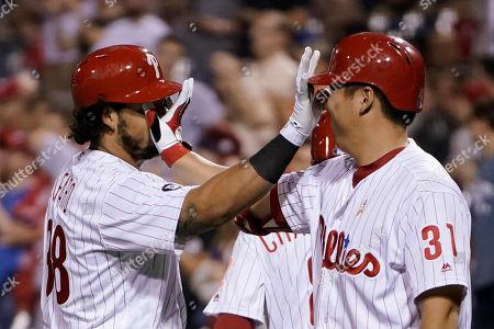 Jorge Alfaro, Hyun Soo Kim. Philadelphia Phillies' Jorge Alfaro, left, and Hyun Soo Kim celebrate after Alfaro's two-run home run during the sixth inning of a baseball game against the Oakland Athletics, in Philadelphia. Philadelphia won 5-3