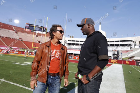 Actor Matthew McConaughey and former Texas Longhorns great Vince Young in attendance during the game against the Texas Longhorns and the USC Trojans at the Los Angeles Coliseum in Los Angeles, California