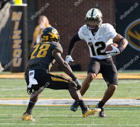 Stock Picture of Logan Cheadle, Jared Sparks. Purdue's Jared Sparks, right, tries to run past Missouri's Logan Cheadle during the second quarter of an NCAA college football game, in Columbia, Mo