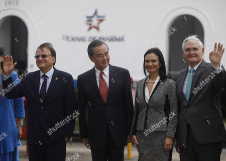 L-R, Panamanian Minister for Panama Canal Issues Roberto Roy, Chinese Foreign Minister Wang Yi, Panamanian Foreign Minister and Vice President Isabel de Saint Malo and Panama Canal Authority administration Jorge Luis Quijano pose during a visit at Miraflores lock in the Panama Canal, Panama, 17 September 2017.