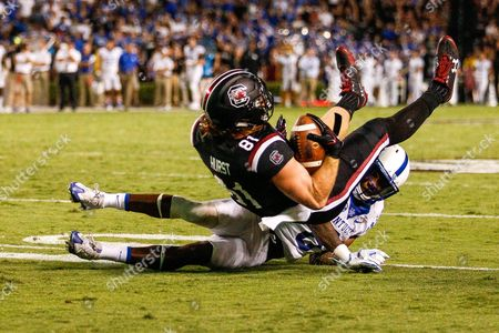Hayden Hurst (81) of the South Carolina Gamecocks gets up ended by Lonnie Johnson (6) of the Kentucky Wildcats shy of the end zone in the fourth quarter of the NCAA football matchup between the Kentucky Wildcats and the South Carolina Gamecocks at Williams-Brice Stadium in Columbia, SC