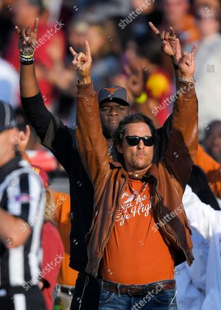 Matthew McConaughey, Vince Young. Actor Matthew McConaughey, right, and former Texas quarterback Vince Young gesture as the Texas team runs out onto the field prior to an NCAA college football game between Southern California and Texas, in Los Angeles
