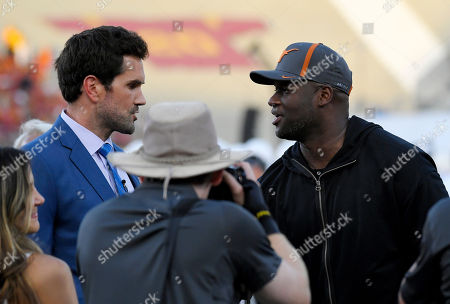 Matt Leinart, Vince Young. Former Southern California quarterback Matt Leinart, left, and former Texas quarterback Vince Young talk during the first half of an NCAA college football game between the teams, in Los Angeles