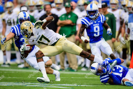 Duke safety Jordan Hayes (13) brings down Baylor wide receiver Pooh Stricklin (17) during the NCAA college football game between Baylor and Duke on at Wallace Wade Stadium, in Durham, NC