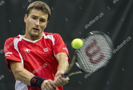 Marco Chiudinelli of Switzerland returns the ball to Yaraslav Shyla of Belarus during the fifth match of the Davis Cup world group playoffs between Switzerland and Belarus at the Swiss Tennis Arena in Biel, Switzerland, 17 September 2017.