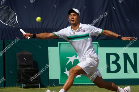 Stock Picture of Wishaya Trongcharoenchaikul, of Thailand, returns the ball to Aisam-ul-Haq Qureshi, of Pakistan during the Davis Cup Asia Oceania Group II third round match at the Pakistan Sport Complex in Islamabad, Pakistan