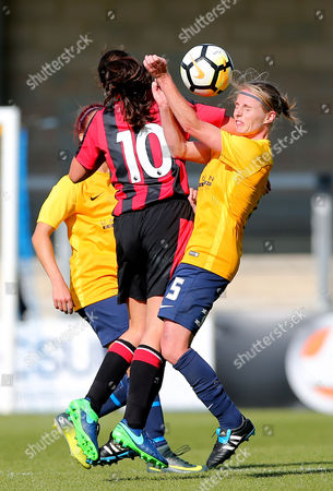 Sarah Smith of Torquay United Ladies takes an elbow in the face from Chloe Tape of AFC Bournemouth during the Women's FA Cup match between Torquay United Ladies and Bournemouth at Plainmoor, Torquay, Devon on September 17