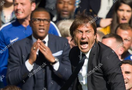 Angry  Chelsea manager Antonio Conte with Chelsea Technical director Michael Emenalo standing behind