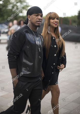 Ne-Yo and Crystal Renay entering Versace show