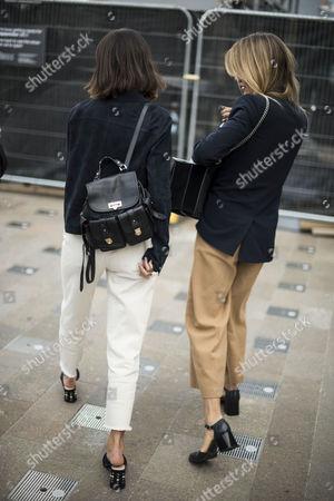 Sarah Halpin and Joanna Halpin leaving Versace show