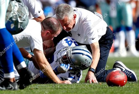 Dallas Cowboys cornerback Nolan Carroll (24) is help after being injured on a play during the first half of an NFL football game against the Denver Broncos, in Denver