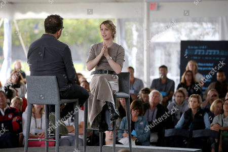 Eugene Jarecki, Chelsea Manning. Chelsea Manning, center, is interviewed by filmmaker Eugene Jarecki, left, during a forum, in Nantucket, Mass. The forum is part of The Nantucket Project's annual gathering on the island of Nantucket. Manning is a former U.S. Army intelligence analyst who spent time in prison for sharing classified documents