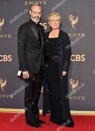 Michael Gill, Jayne Atkinson. Michael Gill, left, and Jayne Atkinson arrive at the 69th Primetime Emmy Awards, at the Microsoft Theater in Los Angeles