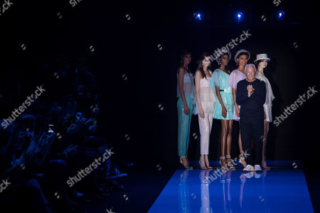 Stock Photo of Italian fashion designer Georgio Armani, front right, accepts applause after the Emporio Armani Spring/Summer 2018 runway show at London Fashion Week in London