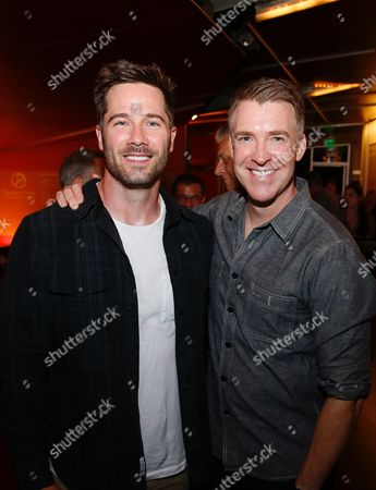 Luke Macfarlane and Brian Hutchison