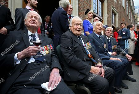 Battle of Britain veterans (left to right) Wing Commander Tom Neil, Squadron Leader Geoffrey Wellum, Wing Commander Tim Elkington and Wing Commander Paul Farnes watch a flypast following a service marking the 77th anniversary of the Battle of Britain at Westminster Abbey