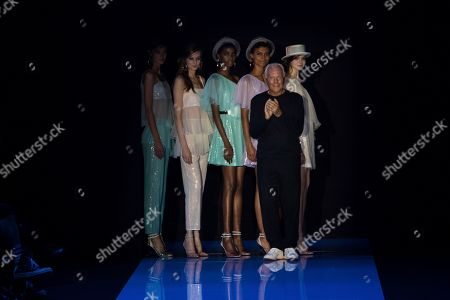 Italian fashion designer Georgio Armani, front right, accepts applause after the Emporio Armani Spring/Summer 2018 runway show at London Fashion Week in London